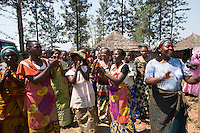 Africa, DRC, Democratic Republic of the Congo, South Kivu, Kamanyola. Women for Women project. WFW Kamanyola co-op and lifeskills training. Women dancing in greeting.