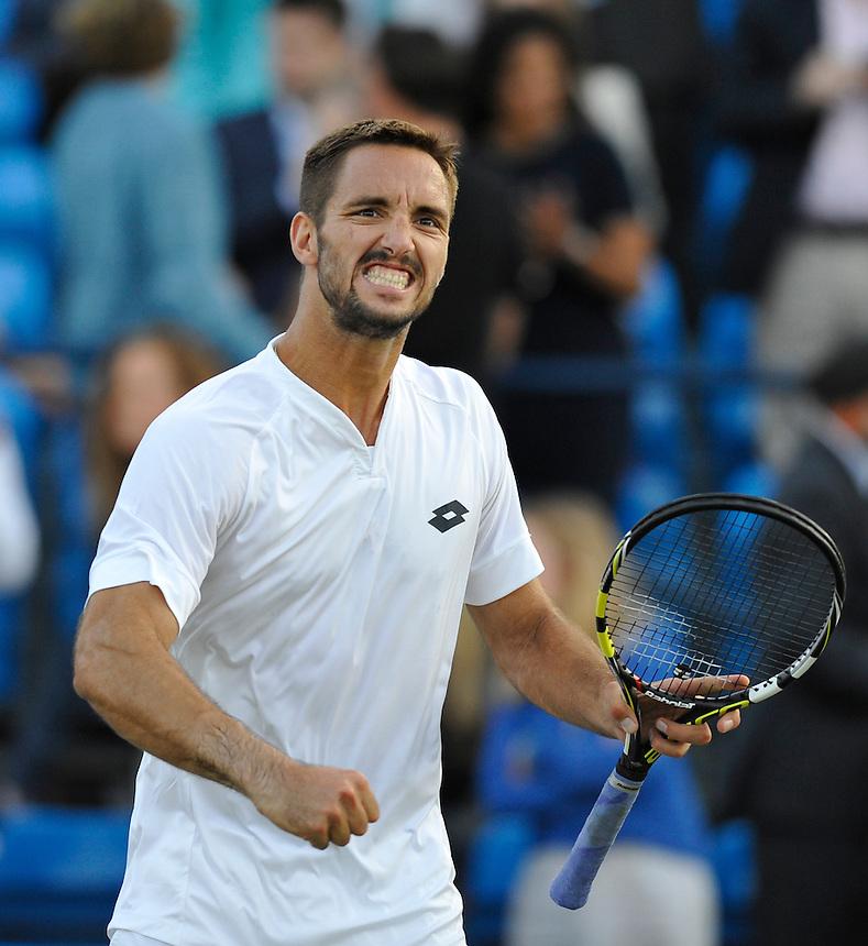 Viktor Troicki (SRB) celebrates his victory over John Isner (USA) in their Men&rsquo;s Singles Quarter Final match - Viktor Troicki (SRB) def John Isner (USA) 7-6, 6-3<br /> <br /> Photographer Ashley Western/CameraSport<br /> <br /> Tennis - ATP 500 World Tour - AEGON Championships- Day 5 - Friday 19th June 2015 - Queen's Club - London <br /> <br /> &copy; CameraSport - 43 Linden Ave. Countesthorpe. Leicester. England. LE8 5PG - Tel: +44 (0) 116 277 4147 - admin@camerasport.com - www.camerasport.com