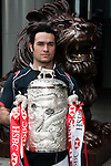 International rugby player Simon Leung of Hong Kong the Top 5 nations competing in this year's HSBC Asian 5 Nations poses with the tournament trophy near the iconic HSBC lion on January 19, 2011 in Hong Kong, China. Japan is the defending champions. Photo by Victor Fraile