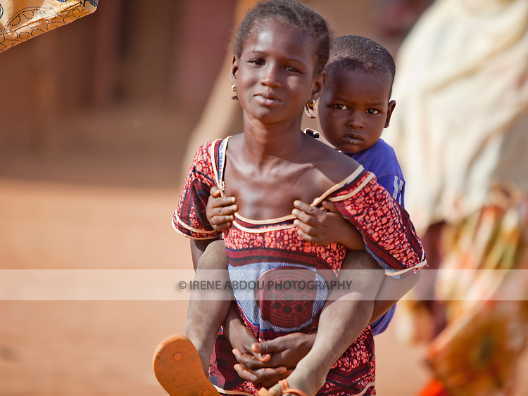 Girl and younger brother in Djibo in northern Burkina Faso.