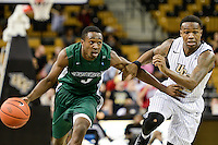 December 7, 2013 - Orlando, FL, U.S: Central Florida guard Brandon Goodwin (22) defends Stetson guard B.J. Glasford (4) during 1st half mens NCAA basketball game action between the Stetson Hatters and the UCF Knights at the CFE Arena in Orlando, Fl.