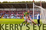 Kieran Donaghy Kerry in action against goalkeeper Ken O'Halloran Cork in the National Football League at Pairc Ui Rinn on Sunday.