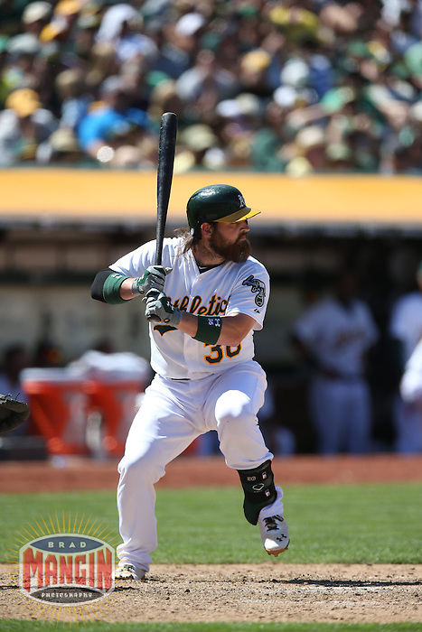 OAKLAND, CA - JULY 6:  Derek Norris of the Oakland Athletics bats during the game against the Toronto Blue Jays at O.co Coliseum on Sunday, July 6, 2014 in Oakland, California. Photo by Brad Mangin