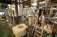 NoDa  Community - NoDa Brewing Company located on Davidson Street in the Charlotte's NoDa Community. Visitors to the brewery can sip on a cold brew while getting an insiders view of the stainless steel brew kettles and fermenters onsite.<br /> <br /> - Bart Roberts, an employee at NoDa Brewing Company works to mash in a batch of hot water and gains, to start the brewing process at the NoDa company.<br /> <br /> <br /> Charlotte Photographer - PatrickSchneiderPhoto.com