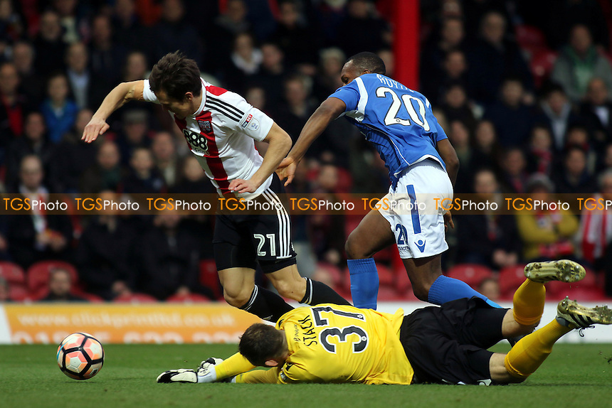 Brentford's Lasse Vibe is fouled by Eastleigh goalkeeper, Graham Stack, and earns a penalty for Brentford during Brentford vs Eastleigh, Emirates FA Cup Football at Griffin Park on 7th January 2017