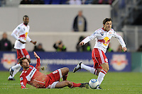 Peter Lowry (8) of the Chicago Fire attempts a tackle on Sinisa Ubiparipovic (8) of the New York Red Bulls during the first half of a Major League Soccer match between the New York Red Bulls and the Chicago Fire at Red Bull Arena in Harrison, NJ, on March 27, 2010. The Red Bulls defeated the Fire 1-0.