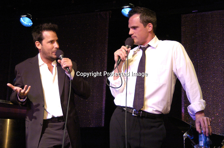 Ricky Paull Goldin and Michael Park singing..at The Goldin and Park Cabaret starring Ricky Paull Goldin from Guiding Light and Michael Park from As The World Turns. Kim Zimmer, Robert Newman and Mandy Bruno also sang. This was at The Triad NYC on April 16, 2005, and  was a benefit for Bill Runyon's family. ..Photo by Robin Platzer, Twin Images
