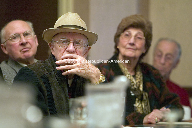 WATERBURY, CT. 14 March 2007--15_NEW_031407SV05--Qemal Laim of Wolcott listens to a speaker during a seminar on Medicare Part D at the Connecticut Grand Hotel in Waterbury Wednesday.<br /> Steven Valenti Republican-American