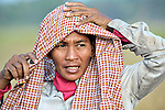 Mean Thorn, a woman in the Cambodian village of Somrith, prepares for work harvesting rice. She is a member of a community rice bank organized by the Community Health and Agricultural Development program of the Methodist Mission in Cambodia..