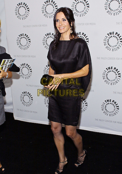 """COURTENEY COX ARQUETTE .27th Annual PaleyFest Presents """"Cougar Town""""  held at the Saban Theatre, Beverly Hills California, USA..March 5th, 2010.full length black dress courtney open toe shoes clutch bag ankle strap peep silk satin .CAP/ADM/TC.©T. Conrad/AdMedia/Capital Pictures."""