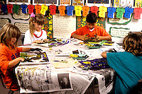 Students in 3rd third grade doing art project in schoo