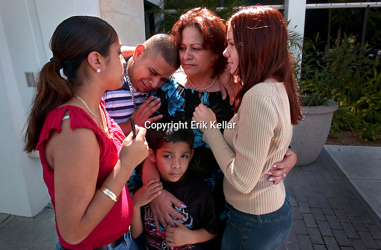 After saying good-bye to her husband, Robert Johnson, Maria Johnson, center, comforts and is comforted by some of her family from left; Hilda Garcia, 13, her niece, Francisco Gamez, 21, left, her son,  Ellie Mae Johnson, 13, right, her daughter, Immanuel Rivas, 6, her nephew, outsdie Lee Memorial Hospital in Ft. Myers while her daughter Adrianna Johnson is still on life support Friday. drianna was in a car accident in San Carlos Park Estates on April 25th after Adrianna took her sister's car to pick up a friend and, on the way, lost control of the car and crashed, suffering mutiple head traumas and a broken leg. Erik Kellar/Staff
