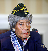 110-year-old Emma Didlake of Detroit, Michigan, the nation's oldest living veteran, who served as a highly decorated private in the Women's Army Auxiliary Corps (WAAC) during World War II, visits the Oval Office of the White House to meet United States President Barack Obama on July 17, 2015 in Washington, DC.  She is visiting Washington, DC, for her Honor Flight, provided by the Honor Flight Network.<br /> Credit: Olivier Douliery / Pool via CNP