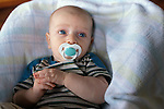 Berkeley CA  Baby six months old being calmed with pacifier while sitting in infant seat  MR