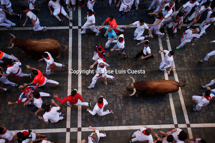 First day of bull run in Estafeta street, Pamplona, northern of Spain.  San Fermin festival is worldwide known because the daily running bulls.