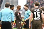 10.03.2019,  GER; 2. FBL, FC St. Pauli vs Hamburger SV ,DFL REGULATIONS PROHIBIT ANY USE OF PHOTOGRAPHS AS IMAGE SEQUENCES AND/OR QUASI-VIDEO, im Bild Christopher Avevour (Pauli #06) diskutiert mit Schiedsrichter Dr. Felix Brych (Muenchen) Foto © nordphoto / Witke