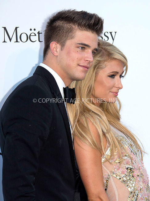 WWW.ACEPIXS.COM....US Sales Only....May 23 2013, New York City....Paris Hilton and River Viiperi at amfAR's Cinema Against AIDS Gala at the Hotel du Cap Eden Roc during the Cannes Film Festival on May 23 2013 in France....By Line: Famous/ACE Pictures......ACE Pictures, Inc...tel: 646 769 0430..Email: info@acepixs.com..www.acepixs.com