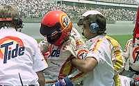 Jummy Horton is pulled from his car by crew chief Jeff Hammond after being overcome by fumes during the Pepsi 400 at Daytona International Speedway, Daytona Beach, FL, July 7, 1990 (Photo by Brian Cleary/www.bcpix.com)
