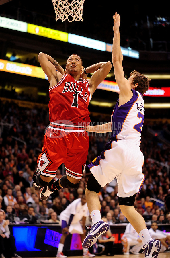 Jan. 22, 2010; Phoenix, AZ, USA; Chicago Bulls guard (1) Derrick Rose goes up for a dunk against Phoenix Suns guard (2) Goran Dragic in the fourth quarter at the US Airways Center. Chicago defeated Phoenix 115-104. Mandatory Credit: Mark J. Rebilas-