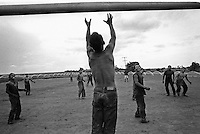 Guarani indians play soccer at the end of the working day as sugarcane cutters in an ethanol plant, Mato Grosso do Sul State, Mid-west Brazil.