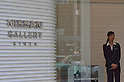 November 2nd, 2011, Tokyo, Japan - A member of staff stands at the entrance to Nissan's Ginza showroom in Tokyo. Nissan Motor Co today announced its Q2 operating profit. This fell 4.6 percent but  beat expectations. This is positive for the company in a time of a strong yen, shaky global economy and flooding in Thailand.
