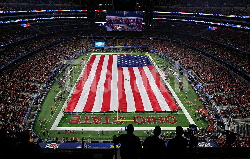 The playing of the National anthem as a bald eagle lands on the sidelines before Ohio State Buckeyes against USC Trojans at the 82nd Goodyear Cotton Bowl Classic at AT&T Stadium in Arlington, Texas on December 29, 2017.  [Kyle Robertson/Dispatch]