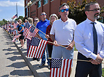 Waterloo residents line up outside Waterloo City Hall as they wait and watch for the procession carrying the body of slain ISP Trooper Nick Hopkins. Dozens of police departments joined in the procession from St. Louis to Waterloo for slain Illinois State Police Trooper Nick Hopkins on Monday August 26, 2019. <br /> Photo by Tim Vizer
