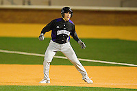 Kyle Ruchim #9 of the Northwestern Wildcats takes his lead off of first base against the Wake Forest Demon Deacons at Gene Hooks Field on February 26, 2011 in Winston-Salem, North Carolina.  Photo by Brian Westerholt / Four Seam Images