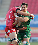 Connacht's Quinn Roux is tackled by Scarlets' Johan Snyman<br /> <br /> Rugby - Scarlets V Connacht - Guinness Pro12 - Sunday 15th Febuary 2015 - Parc-y-Scarlets - Llanelli<br /> <br /> &copy; www.sportingwales.com- PLEASE CREDIT IAN COOK