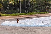 Taking a dip at Mauna Kea Beach on the Big Island of Hawaii.