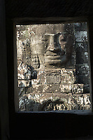 One of the nearly 200 massive faces carved into the towers and walls of the Bayon, Angkor. This temple, one of the most impressive religious constructions in the world, was started by the Khmer Emperor Jayavarman VII in the early 13th century and some scholars think that the faces are representations of him. Others say that they belong to the boddhisattva of compassion called Avalokitesvara or Lokesvara. At various times in its history, it was a Buddhist and a Hindu temple.