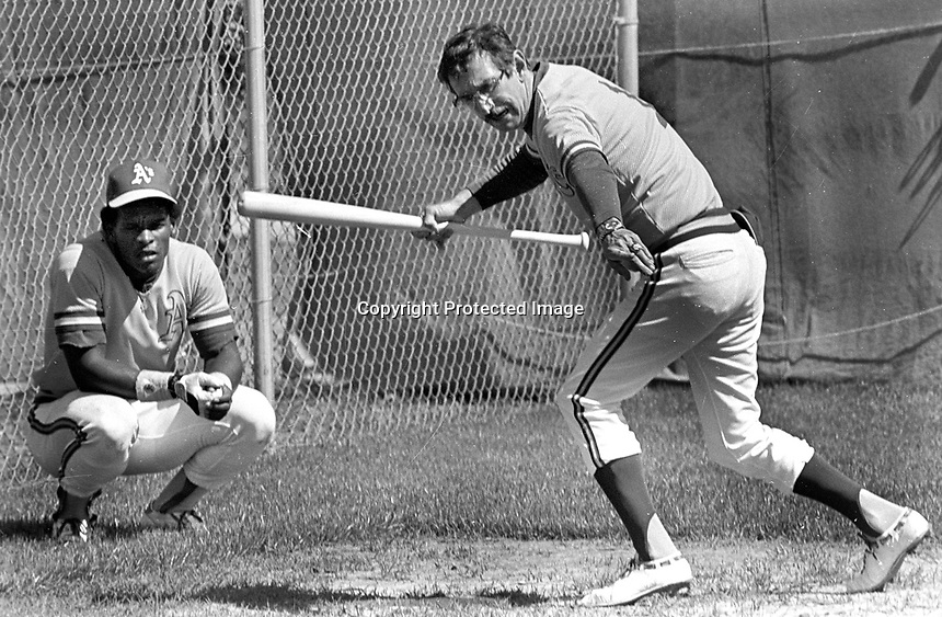 Oakland A's manager Billy Martin teaching Rickey Henderson how to bunt during Spring Training in Arizona..... (1980 photo/Ron Riesterer)