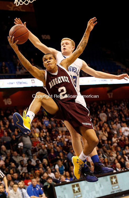 Uncasville, CT- 22 March 2015-032215CM06- Naugatuck's Jarron Chapman (2) goes to the hoop against Bunnell's Patrick Gough during their first half matchup in the Class L state championship game at Mohegan Sun Arena in Uncasville on Sunday.    Christopher Massa Republican-American