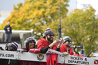 October 31, 2018: Boston Red Sox starting pitcher David Price (24) autographs a baseball to throw to fans during the Boston Red Sox 2018 World Series championship celebration parade held in Boston, Mass.  Eric Canha/CSM