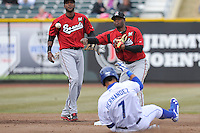 Irving Palu #19 of the Nashville Sounds throws to first base to complete a double play at Werner Park on April 5, 2014  in Omaha, Nebraska.  The Sounds defeated the Storm Chasers 2-1.  (Dennis Hubbard/Four Seam Images)