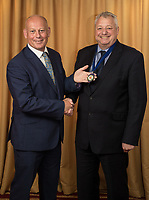 Ian Roberts hands over the President's Medal to incoming Nottingham City Business Club President Richard Cooper