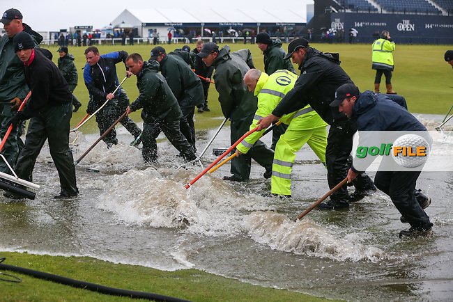 St Andrews Links ground staff get stuck in to clear the surface flooding around the Swilcan Burn on the 18th during the postponement of play of Round Two of the 144th Open, played at the Old Course, St Andrews, Scotland. /17/07/2015/. Picture: Golffile | David Lloyd<br /> <br /> All photos usage must carry mandatory copyright credit (&copy; Golffile | David Lloyd)