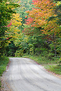 Zealand Road in Bethlehem, New Hampshire USA during the autumn months. This is a seasonal road closed during the snow season. Parts of this road follow the old Zealand Valley Railroad, which was a logging railroad in operation from 1884-1897.