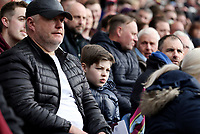 Burnley fans watch the second half action<br /> <br /> Photographer Rich Linley/CameraSport<br /> <br /> The Premier League - Saturday 13th April 2019 - Burnley v Cardiff City - Turf Moor - Burnley<br /> <br /> World Copyright © 2019 CameraSport. All rights reserved. 43 Linden Ave. Countesthorpe. Leicester. England. LE8 5PG - Tel: +44 (0) 116 277 4147 - admin@camerasport.com - www.camerasport.com