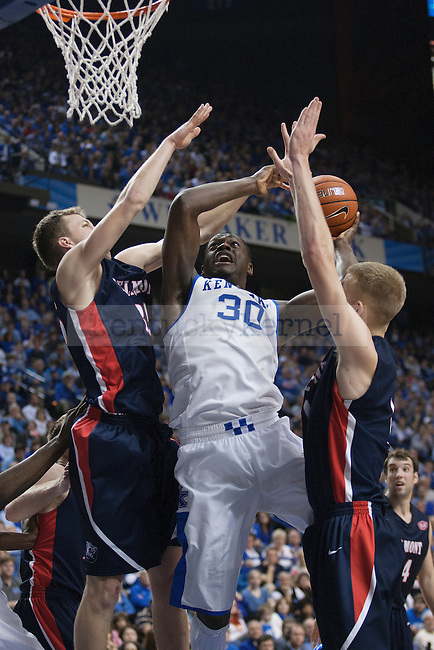 UK forward Julius Randle fights off Belmont defenders for a basket during the second half of the University of Kentucky men's basketball game vs. Belmont University at Rupp Arena in Lexington, Ky., on Saturday, December 21, 2013. Kentucky defeated Belmont 93-80. Photo by Michael Reaves | Staff.