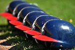 8 March 2011: A line of Braves batting helmets lie on the turf prior to a game between the New York Yankees and the Atlanta Braves at Space Coast Stadium in Viera, Florida. The Yankees edged out the Braves 5-4 in Grapefruit League action. Mandatory Credit: Ed Wolfstein Photo