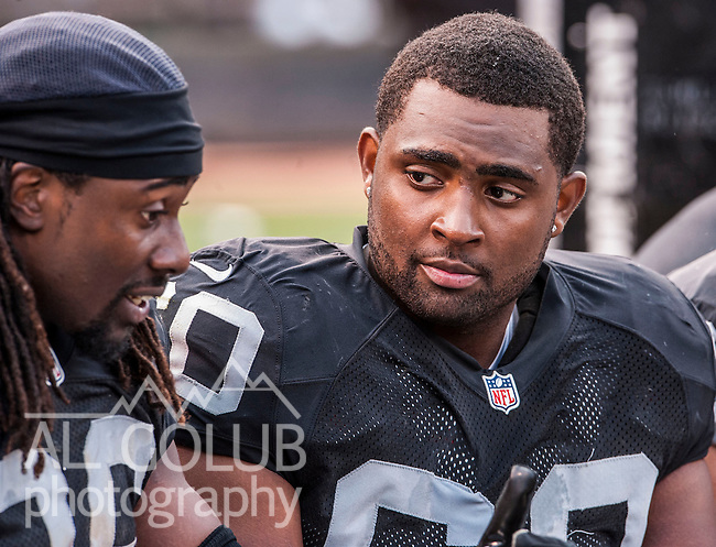 Oakland Raiders vs Detroit Lions at O.co Coliseum Saturday, August 25, 2012. Raiders defeated Lions 31-20 in a preseason game..Oakland Raiders offensive tackle Kevin Haslam (60) listens to tight end David Ausberry (86) on the bench..