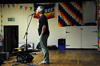 Machynlleth, Wales. 28th July, 2017. <br /> Tony Cordon, musician and festival director, introducing the speakers of the opening festival plenary session, 'Another Future is Still Possible'. <br /> Photographer; Kevin Hayes