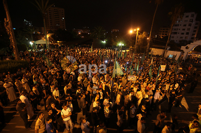 Palestinian members of Hamas celebrate a deal that will see Palestinian detainees freed in exchange for captured Israeli soldier Gilad Shalit on October 11, 2011, in Gaza City. Shalit was captured in 2006 by Hamas-allied militants in the Gaza Strip. Photo by Ali Jadallah