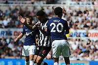 Dele Alli of Tottenham Hotspur nudges Jamaal Lascelles of Newcastle United during Newcastle United vs Tottenham Hotspur, Premier League Football at St. James' Park on 13th August 2017