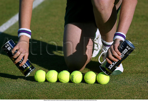 Ballboy opens new tube of balls, Womens Singles Round 4, Wimbledon 2002, 020701. Photo:Glyn Kirk/Action Plus...Tennis ball ident detail