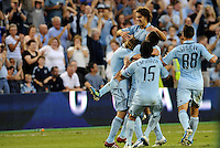 Sporting KC players celebrate Graham Zusi's opening goal... Sporting Kansas City defeated Portland Timbers 3-1 at LIVESTRONG Sporting Park, Kansas City, Kansas.