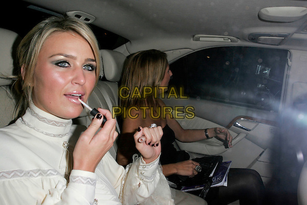 ALEX CURRAN.Leaving the Pride of Britain Awards, London Television Centre, South Bank, London, England, UK, .September 30th, 2008 .half length black nail varnish polish  white cream sixties dress high neck car applying make-up lip gloss diamond ring.CAP/AH.©Adam Houghton/Capital Pictures.