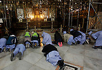 Africans Christian pilgrims pray at the Grotto in the Church of the Nativity, believed to be the birthplace of Jesus Christ, in the West Bank city of Bethlehem on December 22, 2016. Photo by Wisam Hashlamoun