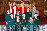 Pupils from Scartaglen NS with Bishop Ray Browne Principal and Fr Maurice Brick at the Confirmation in St Stephens and Johns church Castleisland on Thursday